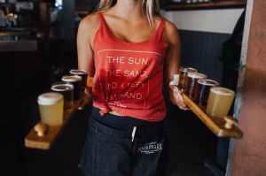 woman holding set of liquor drinks